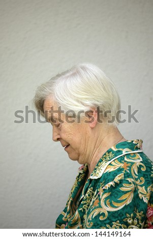 Old woman in profile - stock photo