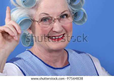 Old woman in rollers - stock photo