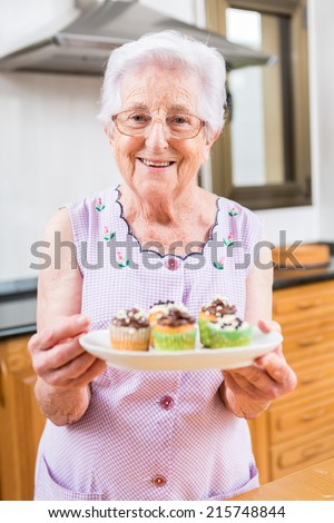Woman Decorating Cupcakes colorful cupcakes frosted variety frosting flavors stock photo