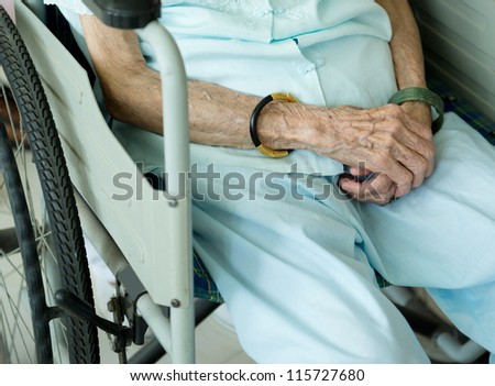 old woman on a wheelchair. - stock photo