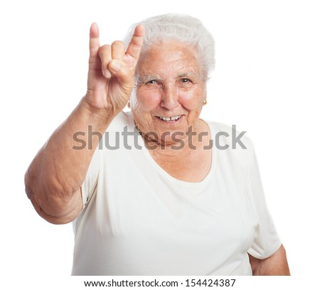 old woman rock gesture on white background