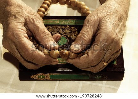 Old woman's hands holding rosary