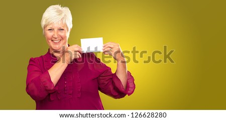Old Woman Showing  Paper On Color Background - stock photo