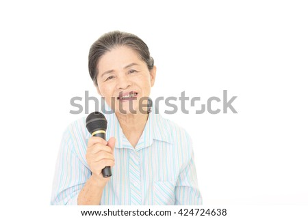 Old woman singing karaoke