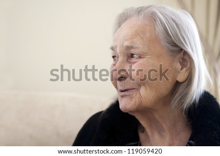 old woman speaks with somebody - stock photo