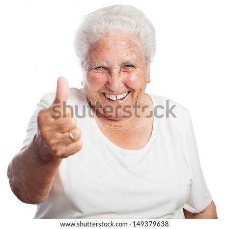 old woman thumb up on a white background - stock photo