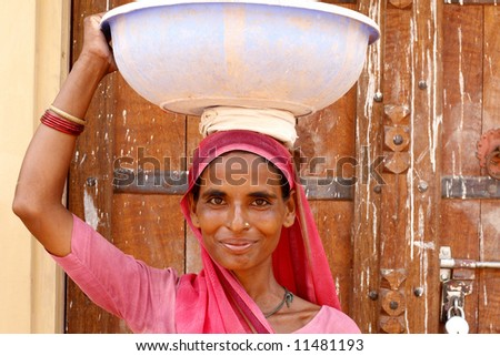 Old woman wearing a beautifully embroidered sari - stock photo