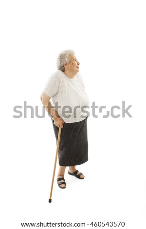 Old woman with a cane looking up. Isolated on white background