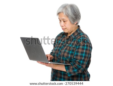 Old woman with a notebook - stock photo