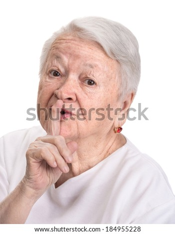 Old woman with finger on lips asking for silence on a white background