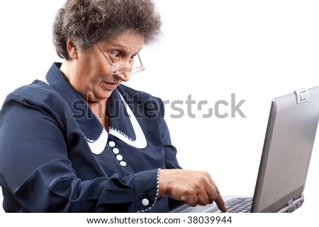 Old woman with glasses using computer