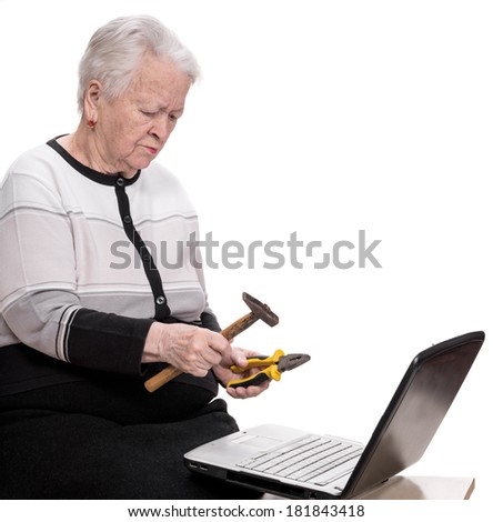 Old woman with holding hammer and pliers on a white background