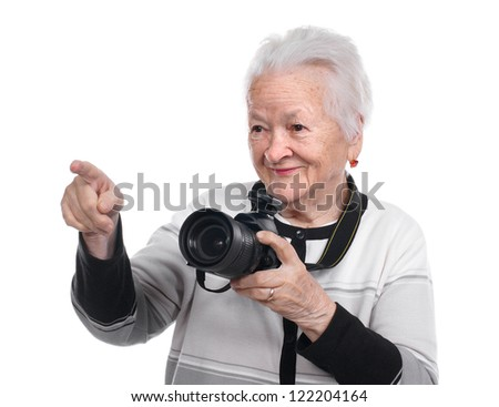 Old woman with photo camera on white background - stock photo