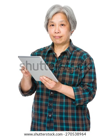 Old woman with tablet - stock photo