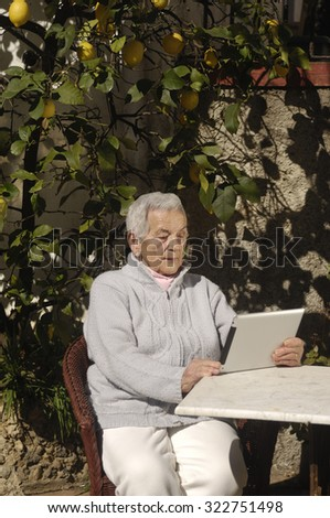 old woman with tablet