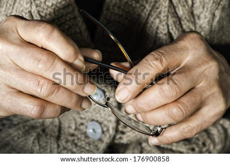 Old women hands hold glasses - stock photo
