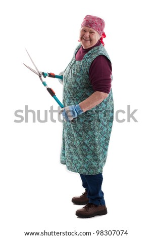 old women with a secateurs - stock photo