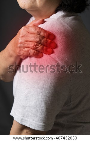 Old women with pain in shoulder - stock photo