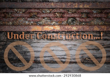 "Old wood and rust chain with word ""Under Construction"""