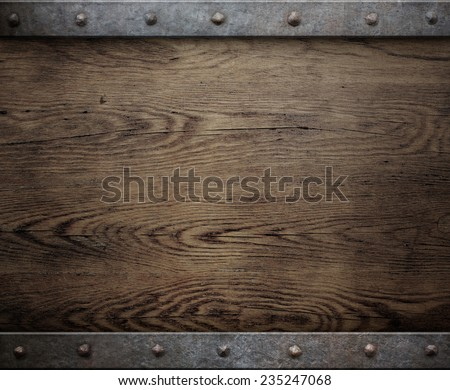 old wood background with metal frame - stock photo