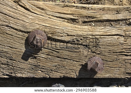 Old wood background with rusty screws, cracked - stock photo