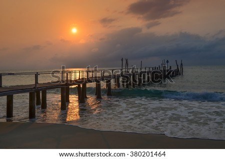 Old wood bridge,  mooring pier,  nobody against beautiful sunset sky, natural background ,backdrop and sea scene, Ko Samet, Thailand - stock photo