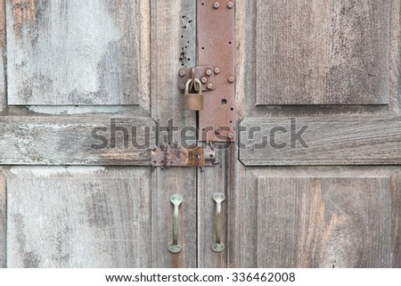 Old Wood Doors and Key lock - stock photo