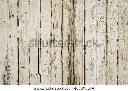 Old Wood Exterior Wall with Peeling Beige Paint
