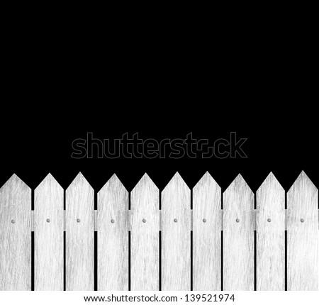 Old wood fence on black background - stock photo