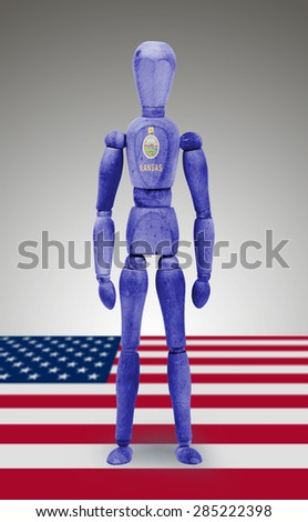 Old wood figure mannequin with US state flag bodypaint - Kansas - stock photo