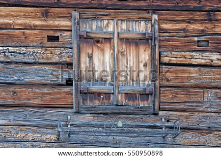 Old wood mountain cabin house window