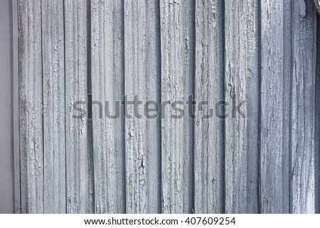 old wood painted planks. loose paint flakes.