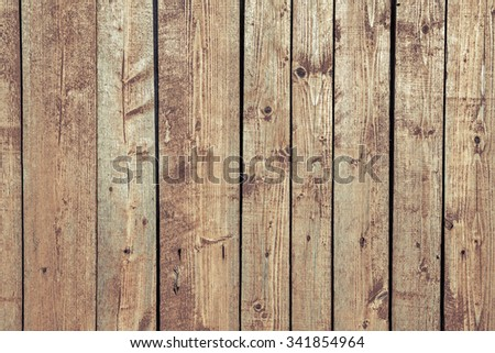 Old wood planks oriented vertically. Wood texture with weathered paint and cross process effect  - stock photo