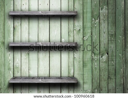 Old wood shelf on wooden wall - stock photo