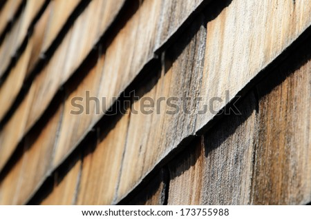 old wood shingle wall covering - stock photo