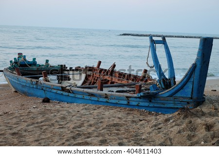 old wood ship wrecked on sea