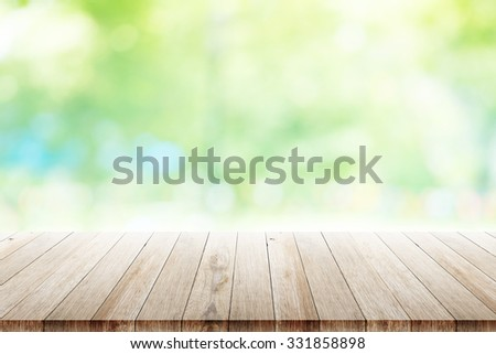 old wood table top on blurred beach background  - stock photo
