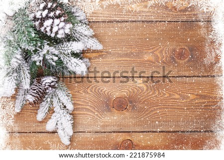 Old wood texture with snow and firtree christmas background - stock photo