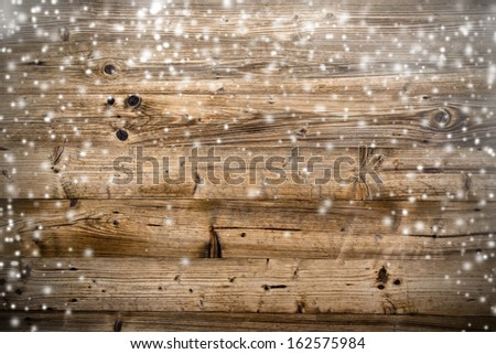 Old wood texture with snow flakes - stock photo