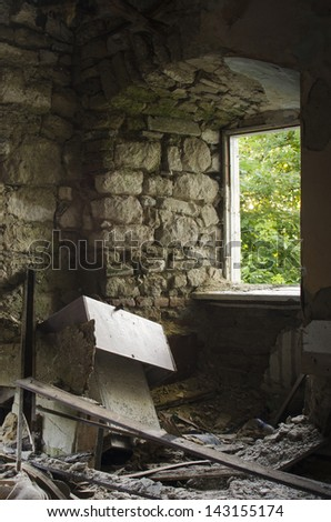 Old wood window in an ancient stone ruin building