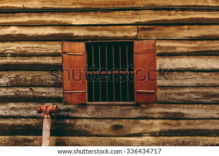 old wood window in the wall wooden house