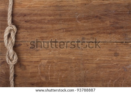 Old wood with rope knot background - stock photo
