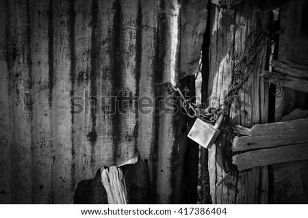 old wooded door lock with chain in black and white - stock photo