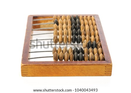 Old wooden abacus. Object isolated on white background