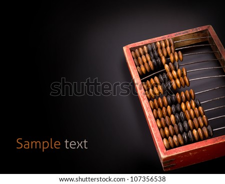 old wooden abacus on a dark background with place for text - stock photo