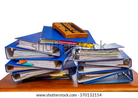 Old wooden abacus on pile of an office folders over white background - stock photo