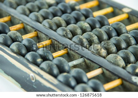 Old wooden abacus on white background - stock photo
