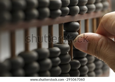 Old wooden abacus with a calculated - stock photo