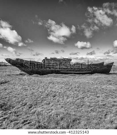 Old wooden and metal boats at Fleetwood Boat Graveyard, Fleetwood, Lancashire, UK