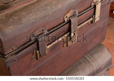 Old wooden antique travel chest used in the past in a stack. Toned image as vintage background.